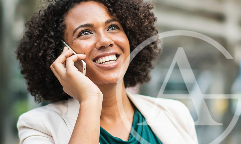 smiling and apparently successful woman talking on cell phone